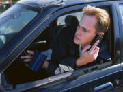 Man driving with telephone