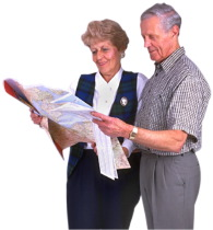 man and woman reading map
