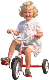 small girl on tricycle